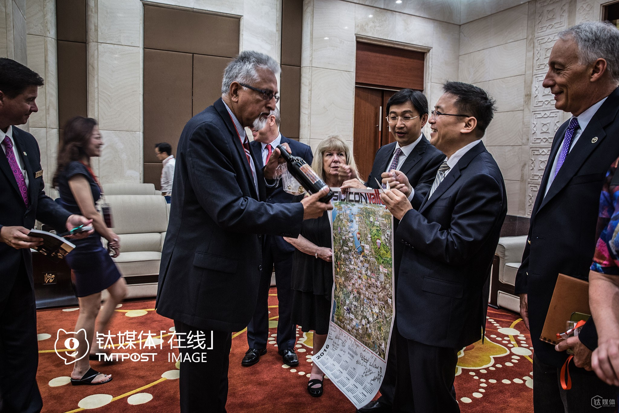 """Before the VR summit in Chongqing began, Mu Huaping, District party secetary of Yubei District, met with the delegation. After the meeting, Silicon Valley mayors gave some gifts to Mr. Mu, including city emblems, souvenirs, red wine, etc. A day before the meeting, a Silicon Valley mayor asked the interpreter: """"Does party secretaries have more power than mayors and vice mayors in China?"""" He'd met party secretaries of some local Chinese government on study tours in the US, but wasn't quite sure of how power was divided in the Chinese political system."""