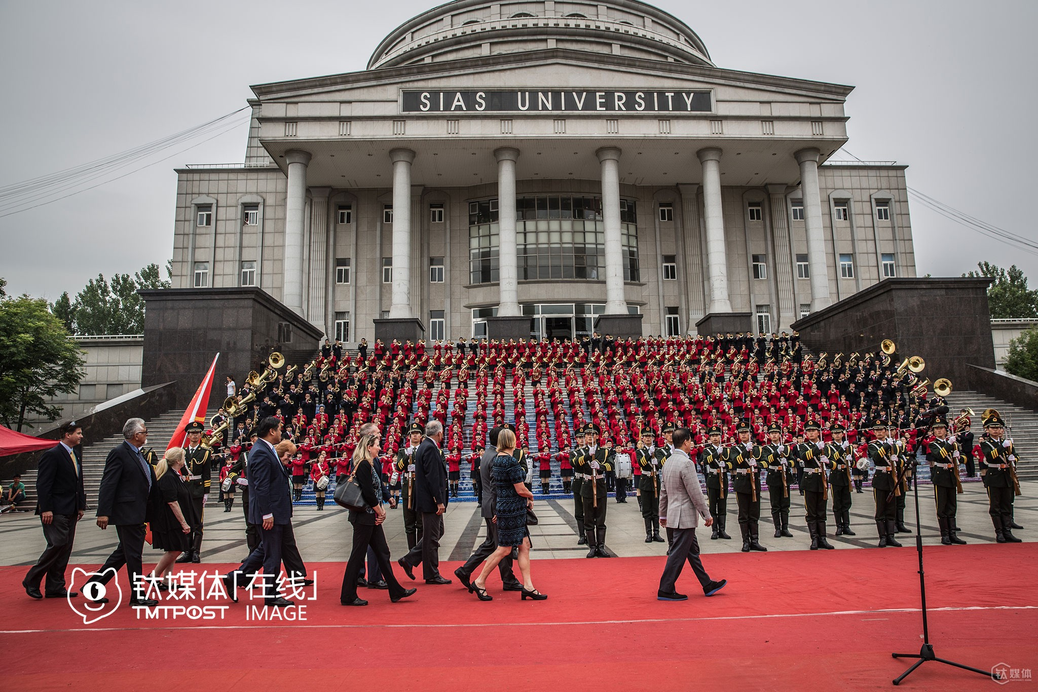 """At the welcome ceremony in campus, honor guards and symphony orchestra of the university were all called out, and reviewed by the delegation, a typical but a little bit old-fashioned way to welcome foreign guests in China. While Silicon Valley mayors were surprised at the warm welcome ceremony, young entrepreneurs from Silicon Valley who travelled along with the delegation, however, found the ceremony amusing. """"That is crazy"""", they exclaimed."""