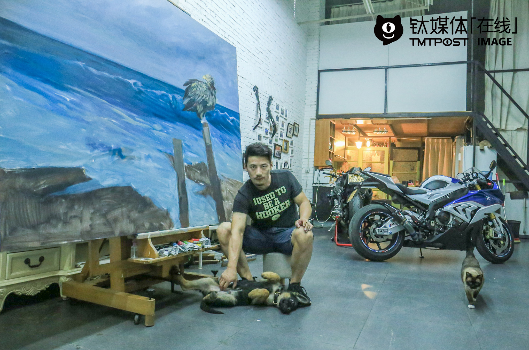 """Xin Zhihua was having a rest in his own art studio. After graduating from the Central Academy of Fine Arts, he became a professional painter and art work dealer. For him, he needs to stay quiet when painting, but get crazy when riding motorcycles. To some degree, riding motorcycles helped him relax himself. """"Deep down, however, I can get really crazy when painting, but stay very quite when riding motorcycles,"""" he explained."""