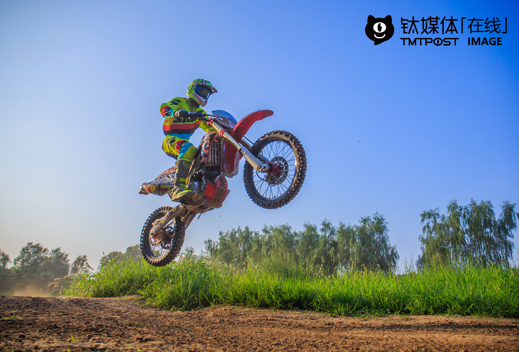 """Racecar driver Sun Jin was training off-road riding on a circuit in suburban Beijing in the above picture. To strengthen his physical endurance and get better prepared for the racecar match to be held at the end of August, he rode for at least 100 rounds every time he trained. """"Riding motorcycles costs more money than what's earned. For one thing, race motorcycle circuit rental fee is high. There aren't many motorcycle circuits in China, so it could be quite expensive to rent motorcycle circuits. For another, it's expensive to fix racecars. On average, three tyres burst after each match. It costs me over 10,000 ($1,507) to replace them. In addition, the application fee is usually a couple thousand yuan, and I have to fix and maintain motorcycles, let alone the fuel cost. In total, I have to pay 20,000 yuan (around $3,014) for each match,"""" he explained, """"I started riding motorcycles nearly a decade ago, and I can no longer remember how many matches I've already participated in. However, even if I win in these matches, I can only get a trophy, not bonus. So I ride just for fun. When riding motorcycles, I feel as if I am the ruler of the world."""" He also ran a motorcycle repair store around the circuit."""