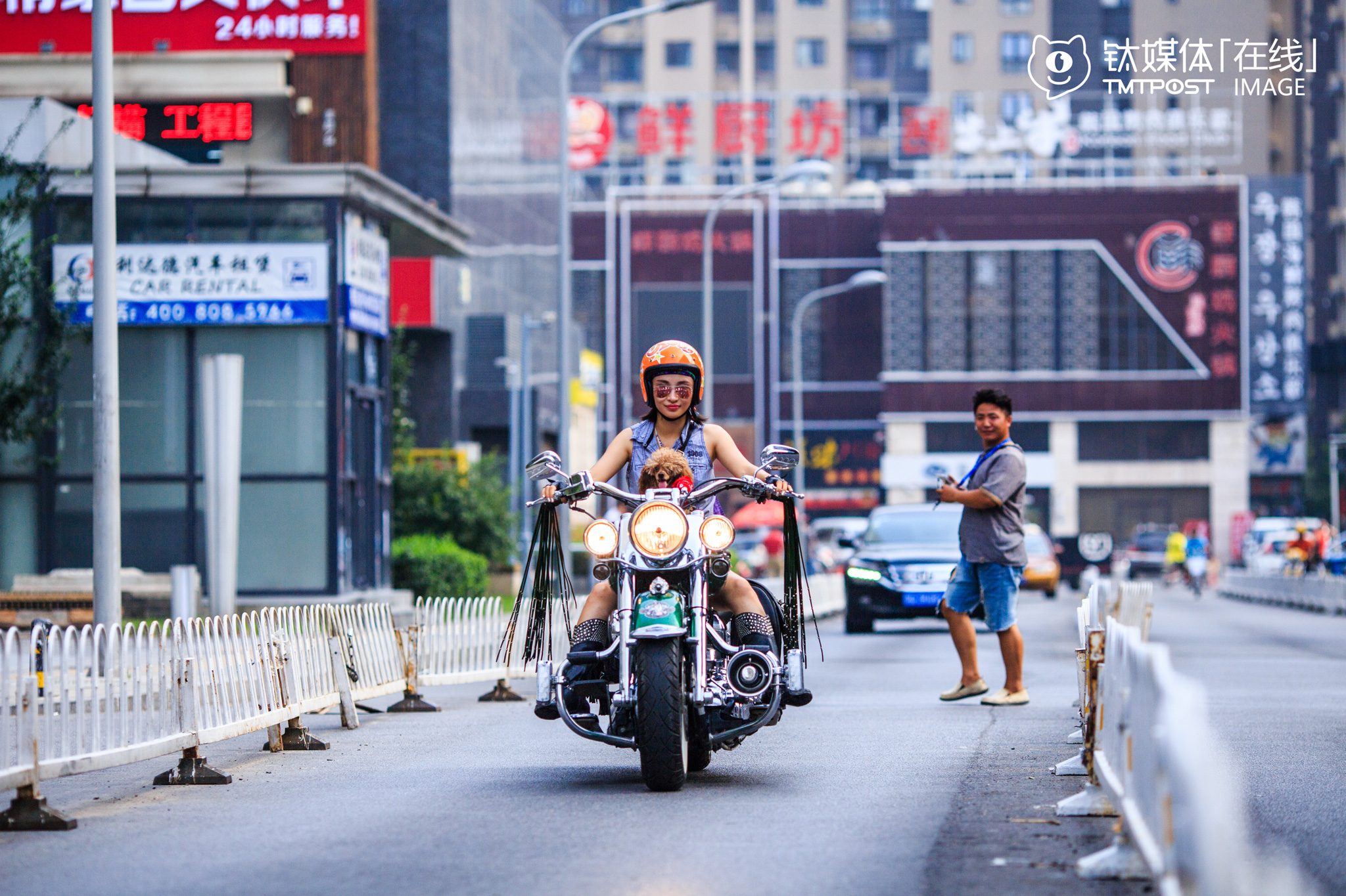 """Yan Han, owner of an interior design studio, is also founder of female Harley motorcycle riders club """"Top Riders"""". She loves Harley motorcycles and bought her first Harley (Harley 883L) four years ago at the price of 300,000 yuan. Her second Harley is modified Softtail Deluxe and cost her 500,000 yuan. """"It's the dream of every motorcycle rider to have a Harley. Different from ordinary motorcycles, Harley represents the pursuit for freedom and happiness instead of pure speed. I travelled on Harley for at least 20,000 kilometers every year,"""" she said."""