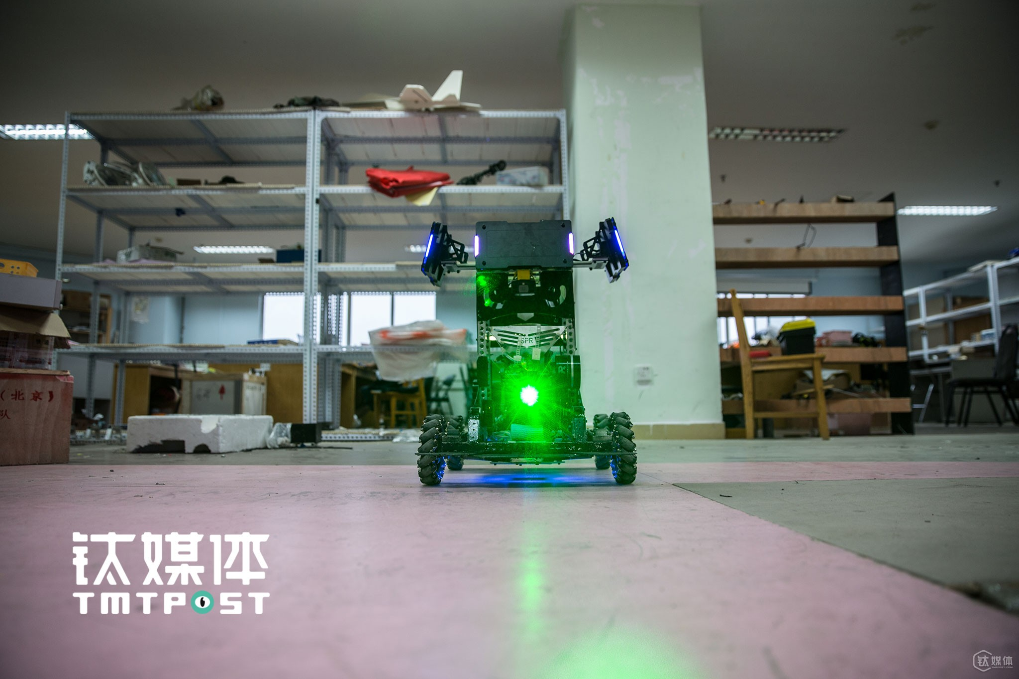 "This is the headquarter of SPR Robot Team, China University of Petroleum. A robot named ""Hero"" began to radiate a ray of green light after it was started."