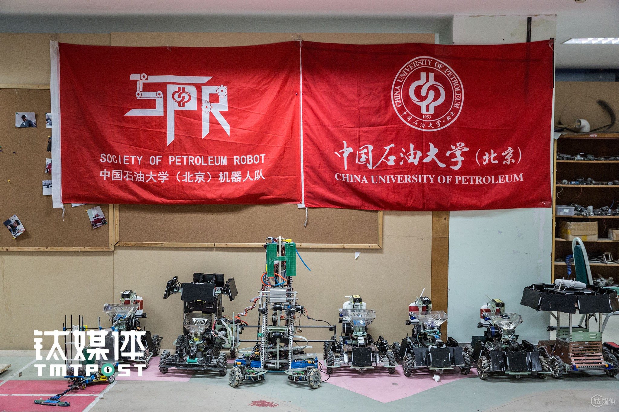 "All the robots of SPR took a group picture under the team flag of SPR. In RoboMasters match, both the team are composed of infantry robot, hero and base. The competing team would ""fight"" with each other in a hall with complicated geographical conditions. The robots are controlled by operators in operating room in a way similar to CF games."