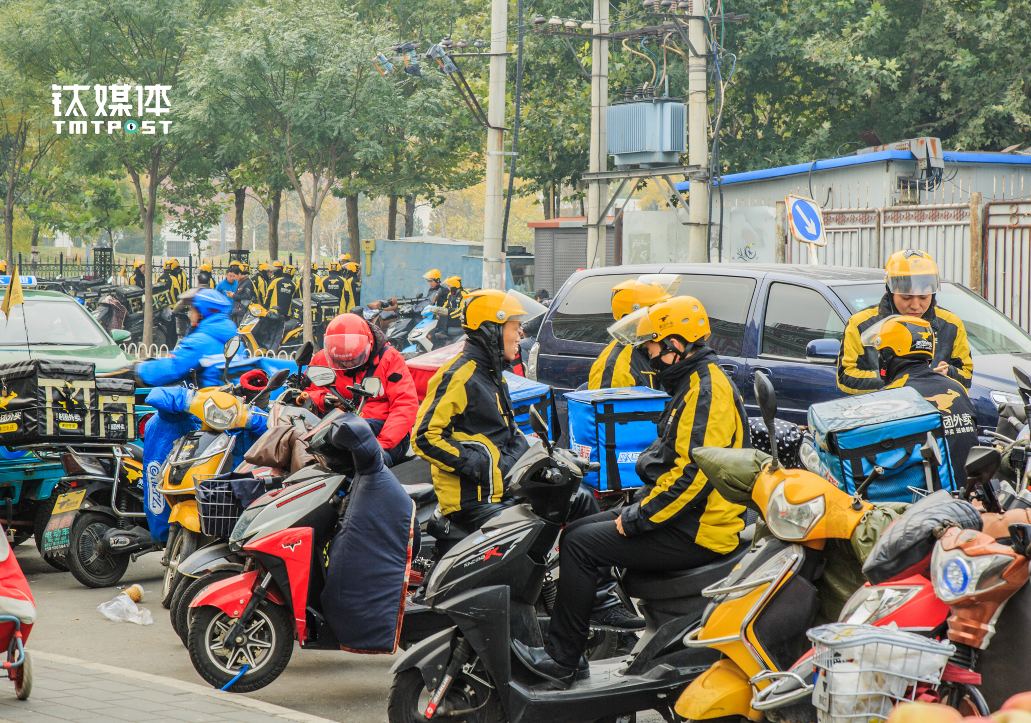 On November 9th 2016, 9 am, at Beijing Jiulongshan, takeout delivery guys from different takeout platforms gathered on the street, waiting for order request from their phones. Another day of work was about to start.